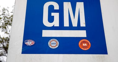 FILE - This Oct. 16, 2019, file photo shows a sign at a General Motors facility in Langhorne, Pa.