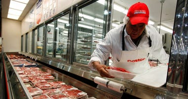 In this Dec. 8, 2009 file photo, a butcher places beef on display at Costco in Mountain View, Calif. U.S. meat supplies are dwindling due to coronavirus-related production shutdowns.