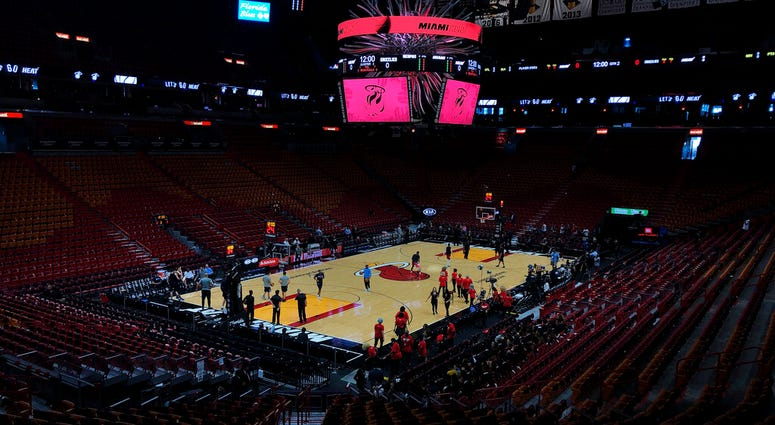 FILE - In this Oct. 23, 2019, file photo, the Miami Heat and the Memphis Grizzlies practice before an NBA basketball game in Miami, Fla.