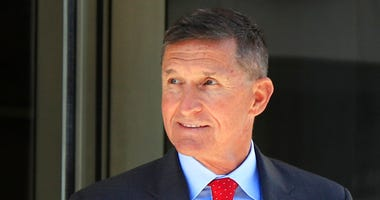 FILE - In this July 10, 2018, file photo, former Trump national security adviser Michael Flynn leaves the federal courthouse in Washington, following a status hearing. (
