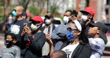 Protesters listen during a rally outside of the City County Building, Thursday, May 7, 2020, in Indianapolis. The crowd was protesting the fatal shooting Wednesday evening by an Indianapolis Metropolitan Police Officer.