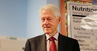 FILE - This Dec. 10, 2019 file photo shows former U.S. President Bill Clinton during a visit to Edward A. Reynolds West Side High School in New York.