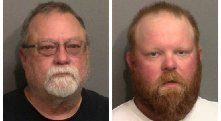 This photo combo of images taken Thursday, May 7, 2020, and provided by the Glynn County Detention Center, in Georgia, show Gregory McMichael, left, and his son Travis McMichael.