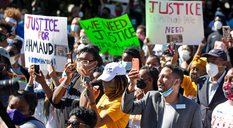 People react during a rally to protest the shooting of Ahmaud Arbery, Friday, May 8, 2020, in Brunswick Ga. Two men have been charged with murder