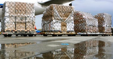 FILE - In this April 10, 2020, file photo, pallets of medical personal protective equipment are unloaded from a Chinese cargo plane at the Los Angeles International airport.