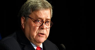 FILE - In this Feb. 10, 2020, file photo, Attorney General William Barr speaks at the National Sheriffs' Association Winter Legislative and Technology Conference in Washington. (AP Photo/Susan Walsh, File)