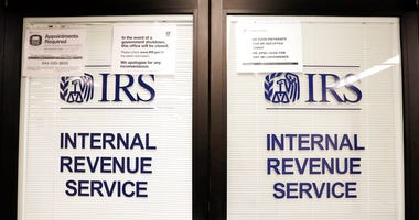 FILE - In this Jan. 16, 2019, file photo, doors at the Internal Revenue Service (IRS) in the Henry M. Jackson Federal Building are locked and covered with blinds as a sign posted advises that the office will be closed during the partial government shutdow