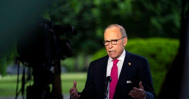 FILE - In this May 8, 2020, file photo White House chief economic adviser Larry Kudlow speaks during an interview on the unemployment numbers caused by the coronavirus, at the White House in Washington.