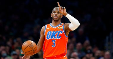 In this March 8, 2020, photo, Oklahoma City Thunder's Chris Paul plays against the Boston Celtics during an NBA basketball game in Boston. (AP Photo/Michael Dwyer)