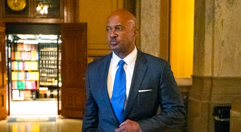FILE - In this Oct. 23, 2019, file photo, Indiana Attorney General Curtis Hill arrives for a hearing at the state Supreme Court at the Statehouse in Indianapolis. Hill's law license will be suspended for 30 days over an allegation that he drunkenly groped
