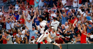 FILE - In this July 4, 2019, file photo, Atlanta Braves' Ozzie Albies rounds first base after hitting a three-run home run during the third inning of the team's baseball game against the Philadelphia Phillies in Atlanta.