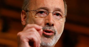 FILE - In this Dec. 29, 2015 file photo, Pennsylvania Gov. Tom Wolf speaks with members of the media at the state Capitol in Harrisburg, Pa.