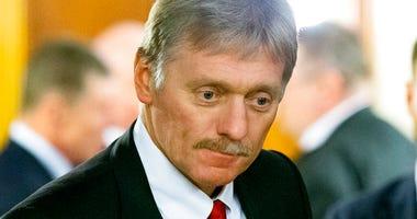 FILE - In this Friday, Feb. 7, 2020 file photo Kremlin spokesman Dmitry Peskov arrives to attend the talks between Russian President Vladimir Putin and Belarusian.   (AP Photo/Alexander Zemlianichenko, Pool, File)