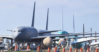 FILE - In this April 7, 2020, file photo, U.S. Air Force KC-46 tankers being built by Boeing sit parked at the Paine Field airport in Everett, Wash.