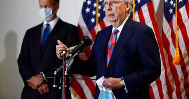 Senate Majority Leader Mitch McConnell of Ky., speaks at a news conference on Capitol Hill in Washington, Tuesday, May 12, 2020. Standing behind McConnell is Senate Majority Whip John Thune, R-S.D.