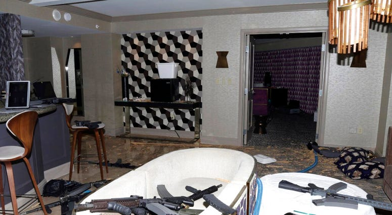 FILE - This October 2017 file photo released by the Las Vegas Metropolitan Police Department Force Investigation Team Report shows the interior of Stephen Paddock's 32nd floor room of the Mandalay Bay hotel in Las Vegas after a mass shooting.