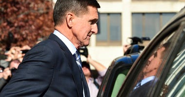 FILE - In this Dec. 1, 2017, file photo, former President Donald Trump national security adviser Michael Flynn leaves federal court in Washington.