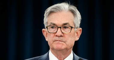 FILE - In this March 3, 2020 file photo, Federal Reserve Chair Jerome Powell pauses during a news conference in Washington.