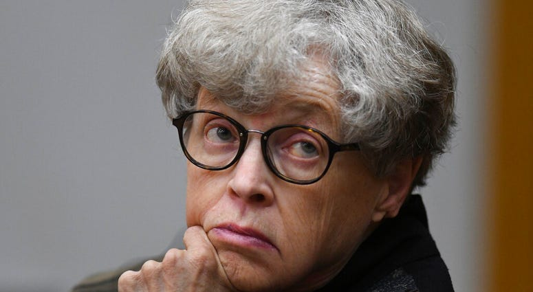FILE - In this April 9, 2019 file photo, former Michigan State University president Lou Anna Simon appears in court in Charlotte, Mich. A judge has dismissed criminal charges Wednesday, May 13, 2020 against Simon arising from the Larry Nassar sexual assau