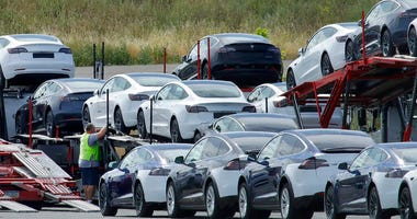 Tesla cars are loaded onto carriers at the Tesla electric car plant Wednesday, May 13, 2020, in Fremont, Calif