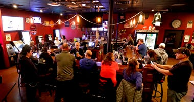 Bars quickly fill following Wisconsin supreme court ruling squashing stay at home order extension
