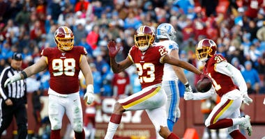 FILE - In this Nov. 24, 2019, file photo, Washington Redskins cornerback Quinton Dunbar (23) reacts after intercepting a pass from Detroit Lions quarterback Jeff Driskel during the second half of an NFL football game in Landover, Md.