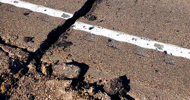 This photo provided by the Nevada Highway Patrol shows earthquake damage that has U.S. Highway 95 closed for repairs after a magnitude 6.5 earthquake struck early Friday, May 15, 2020 in a remote area west of Tonopah.
