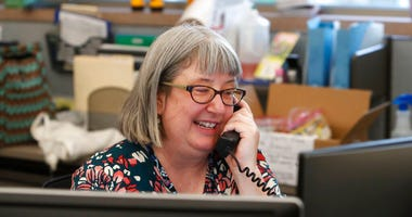 Librarian Holly Ryckman smiles as she chats with 81-year-old Dell Kaplan from the Davis Library in Plano, Texas Friday, May 15, 2020.  (AP Photo/LM Otero)