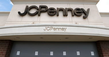 FILE - In this May 8, 2020, file photo, a J.C. Penney store sits closed in Roseville, Mich.