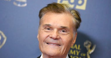 FILE - In this April 26, 2015, file photo, Fred Willard poses in the pressroom at the 42nd annual Daytime Emmy Awards at Warner Bros. Studios in Burbank, Calif. Willard, the comedic actor whose improv style kept him relevant for more than 50 years in film