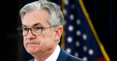 FILE - In this Tuesday, March 3, 2020 file photo, Federal Reserve Chair Jerome Powell pauses during a news conference to discuss an announcement from the Federal Open Market Committee, in Washington.