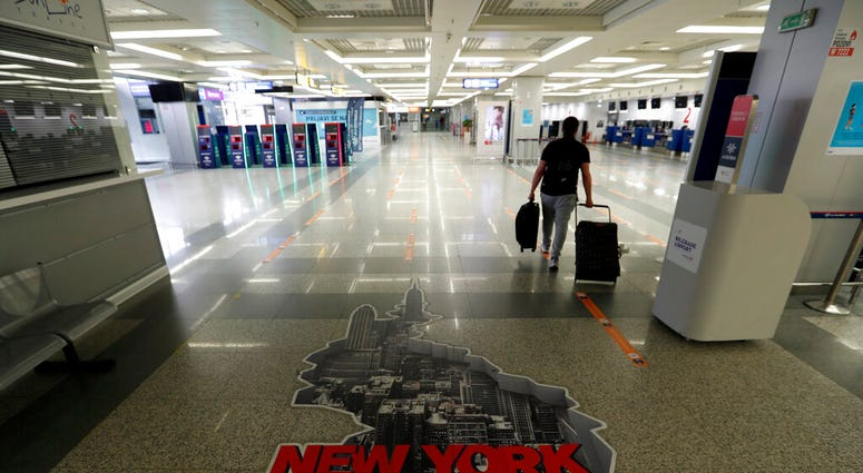 A passenger walks through the Belgrade Nikola Tesla Airport, Serbia, Monday, May 18, 2020.