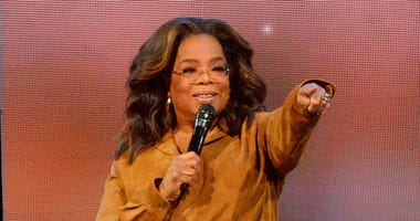 "FILE - This Feb. 8, 2020 file photo shows Oprah Winfrey during ""Oprah's 2020 Vision: Your Life in Focus"" tour in New York. (Photo by Brad Barket/Invision/AP, File)"