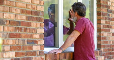 Jack Campise talks with his mother, Beverly Kearns, through her apartment window at the Kimberly Hall North nursing home, Thursday, May 14, 2020 in Windsor, Conn.