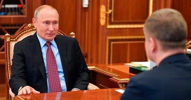 Russian President Vladimir Putin, left, speaks to Russian Railways CEO Oleg Belozyorov during their meeting in the Kremlin, Russia, Monday, May 25, 2020. (Alexei Druzhinin, Sputnik, Kremlin Pool Photo via AP)