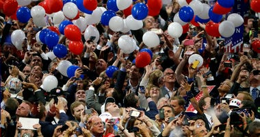 FILE - In this July 21, 2016, file photo, confetti and balloons fall during celebrations after Republican presidential candidate Donald Trump's acceptance speech on the final day of the Republican National Convention in Cleveland.