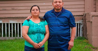 In this photo provided by Cristobal Francisquez, his parents Paulina and Marcos Francisco pose for a photo in front of their house in Sioux City, Iowa, Monday, May 25, 2020.