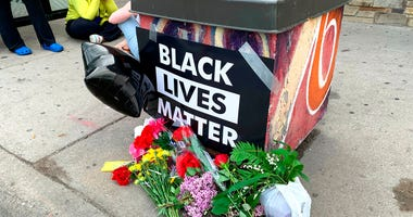 People gather around a makeshift memorial Tuesday, May 26, 2020, in Minneapolis, near where an black man was taken into police custody the day before who later died.   (AP Photo/Jeff Baenen)