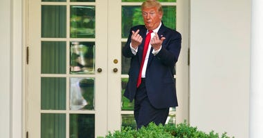 President Donald Trump gestures to people in the audience after an event on protecting seniors with diabetes in the Rose Garden White House, Tuesday, May 26, 2020, in Washington. (