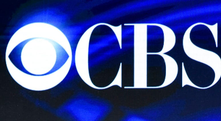 FILE - In this Jan. 12, 2016 file photo, the CBS logo appears onscreen at the Winter TCAs in Pasadena, Calif.  (Photo by Richard Shotwell/Invision/AP, File)