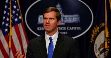 "FILE - In this Feb. 19, 2020 file photo Kentucky Gov. Andy Beshear speaks to the press at the Capitol in Frankfort, Ky. Beshear says protesters who hung an effigy of him were trying to use ""fear and terror"" to force their will on others."