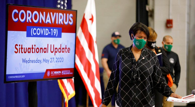 strict of Columbia Mayor Muriel Bowser arrives for a news conference, Wednesday, May 27, 2020, in Washington. Bowser announced the start of the Phase 1 response to the coronavirus in Washington is to begin Friday, May 29.