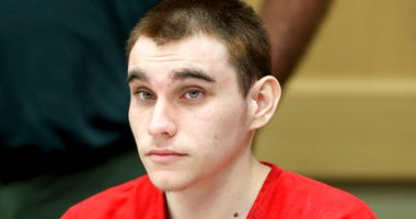 FILE - In this Dec. 10, 2019 Nikolas Cruz appears at a hearing in Fort Lauderdale on Tuesday, Dec. 10, 2019. A mental health provider cannot be held liable for the actions of the man accused of a 2018 Florida high school massacre, an appeals court ruled W