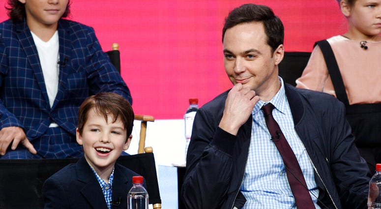 """FILER - In this Aug. 1, 2017 file photo, Iain Armitage, left, a cast member in the CBS series """"Young Sheldon,"""" answers a question as executive producer/narrator Jim Parsons looks on during a panel discussion at the Television Critics Association Summer Pr"""