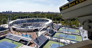 FILE - In this Aug. 24, 2016, file photo, a closed circuit construction camera peers out at the Grandstand stadium during qualifying rounds at the Billie Jean King National Tennis Center in New York.