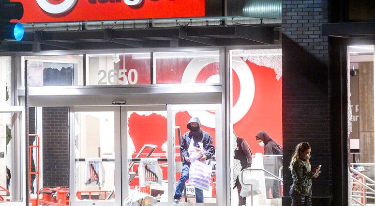 People leave a vandalized Target store in Oakland, Calif., on Saturday, May 30, 2020, during protests against the death of George Floyd, a handcuffed black man in police custody in Minneapolis.