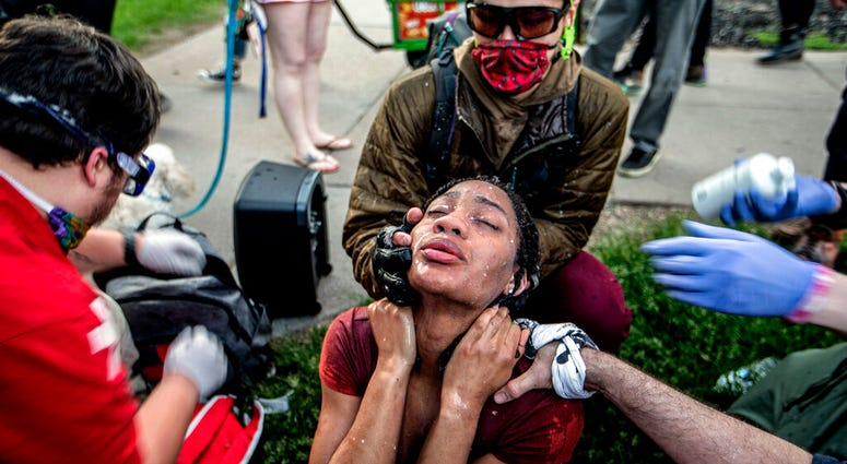 A protester receives care from street medics in Minneapolis, Saturday, May 30, 2020.