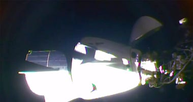 In this image taken from NASA TV video, the SpaceX Dragon crew capsule, with NASA astronauts Doug Hurley and Robert Behnken aboard, docks with the International Space Station Sunday, May 31, 2020.