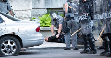 Kentucky State Police detain a man on West Liberty Street on Sunday, May 31, 2020, in downtown Louisville, Kentucky.