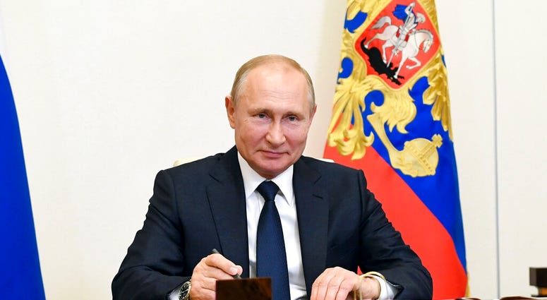Russian President Vladimir Putin, attends a meeting via teleconference at the Novo-Ogaryovo residence outside Moscow, Russia, Monday, June 1, 2020. Putin set a nationwide vote on constitutional amendments allowing him to extend his rule for July 1.